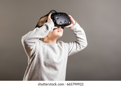 Young girl using a virtual reality headset