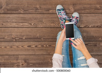 Young girl using white smart phone