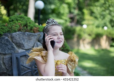 Young girl in a vintage dress with smartphone