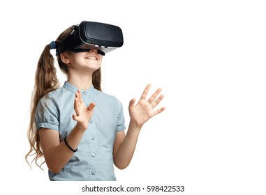 Young girl with virtual reality glasses.  Isolated on white background.  VR headset.