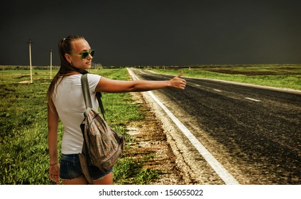 young girl votes on a deserted road