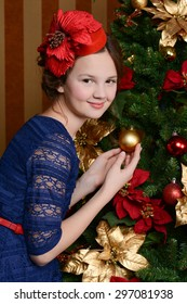 Young girl is waiting for Christmas at her home