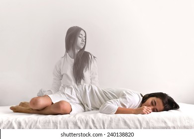 Young girl is waking up again. When the soul leaves the body