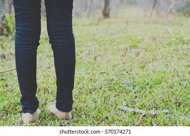 Young girl walking on the meadow