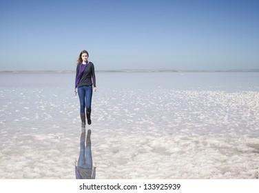 73ca65e337eb young girl walking on the salt lake