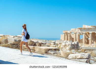 a young girl walks on ancient Greek Acropolis