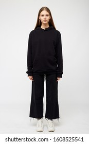 Young girl wearing blank and oversize black long hoody. White background