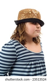 A young girl wearing a funky hat, isolated against a white background