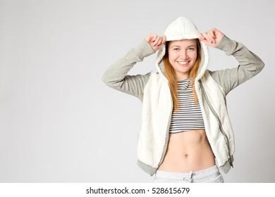 Young girl wearing hoody. Studio shot. Copy space.