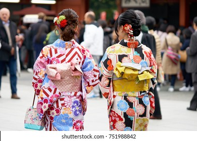 "Young girl wearing Japanese kimono standing in front of Sensoji Temple in Tokyo, Japan. Kimono is a Japanese traditional garment. The word ""kimono"", which actually means a ""thing to wear"""