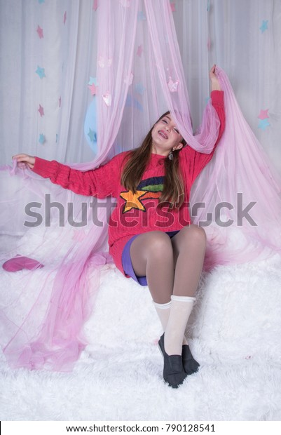 3988604dbf51f3 Young Girl Wearing Pajamas In Bed. Cute teenage princess rest at home.  Happy Holidays
