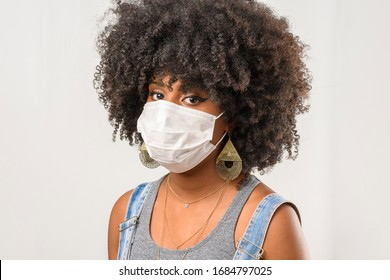 young girl wearing protective mask in corona virus pandemic, covid-19