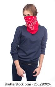 Young girl wearing a scarf over her face like a bandit  isolated