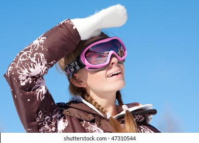 Young girl wearing ski mask on winter resort in Alps