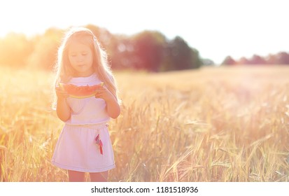 Young girl in a wheat field. Summer landscape and a girl on a nature walk in the countryside. Rest in the village.