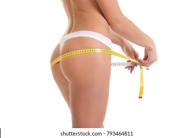 young girl in white underwear measures her ass