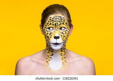 a young girl with a wild and creative leopard make up