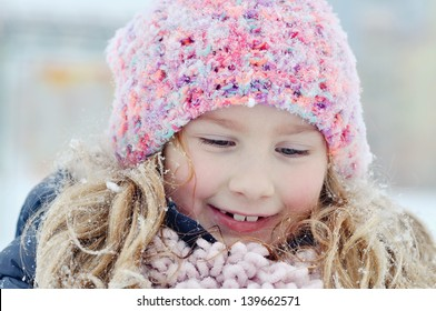 Young girl in a winter scene.