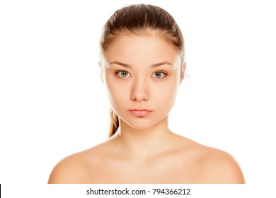 young girl without makeup on white background