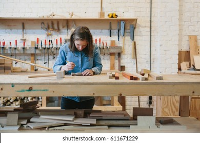 Young girl working in her atelier