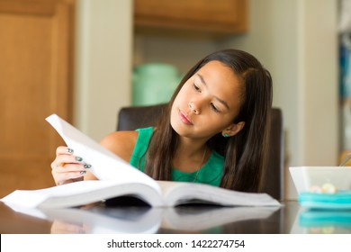 Young girl working on her homework.