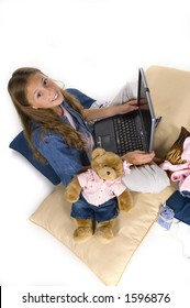 young girl working, playing on laptop computer