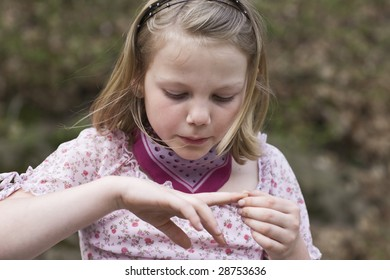 Young girl with wound finger