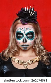 """Young girls with appliance make - up in the style of """"Halloween"""" in the studio on a red background"""