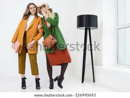 45b7d8bb6 Young Girls Coats Posing Studio Stock Photo (Edit Now) 326990693 ...