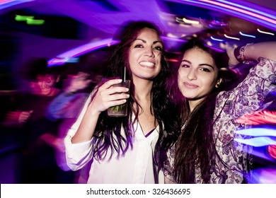 Young girls dancing in the nightclub.