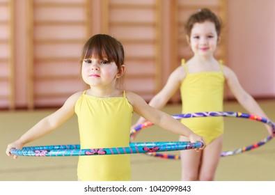 Young girls doing gymnastics.