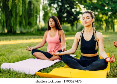 Young girls doing yoga in the park