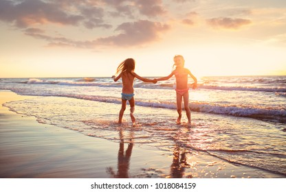 Young girls have fun on a beach