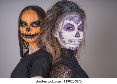 Young girls with horrific faces of the dead in honor of the holiday of Halloween