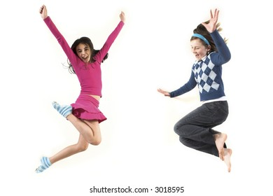 young girls jumping together over white background
