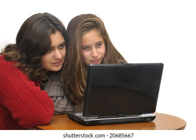 Young girls with laptop isolated against a white background