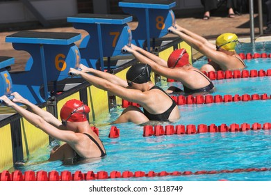 Young girls on the starting block ready to swim