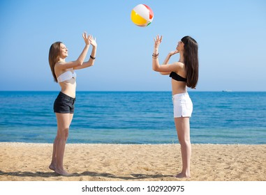 Young girls on vacation by the sea