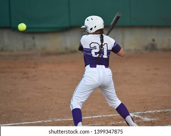 Young girls playing the sport of fastpitch softball