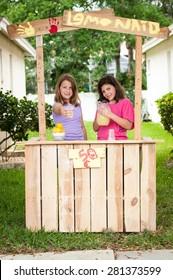 Young girls selling lemonade