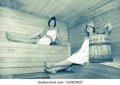 Young girls taking steam bath at sauna