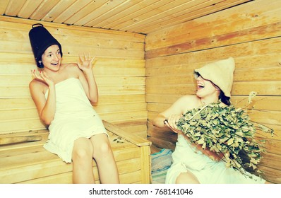 Young girls is taking steam-bath  at sauna