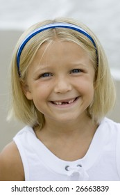 Young Girl's Toothless smile
