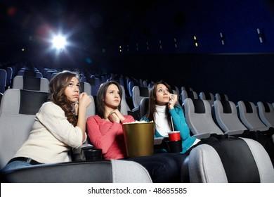 Young girls at viewing of sad cinema