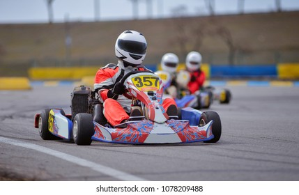 Young go cart racer on circuit