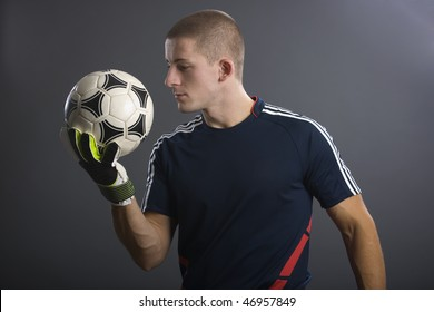Young Goal keeper in soccer on gray background