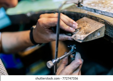Young goldsmith working