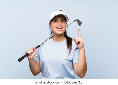 Young golfer Asian girl over isolated blue background intending to realizes the solution while lifting a finger up