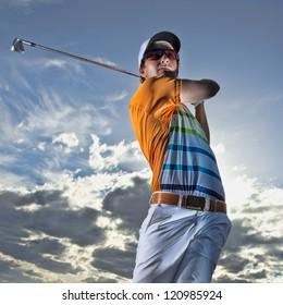 Young golfer hits an iron shot