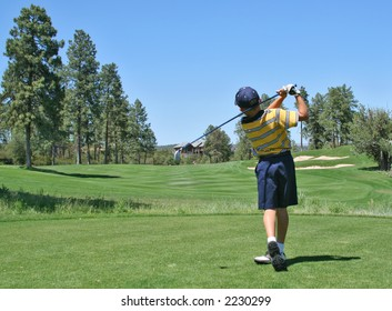 Young golfer hitting a nice tee shot
